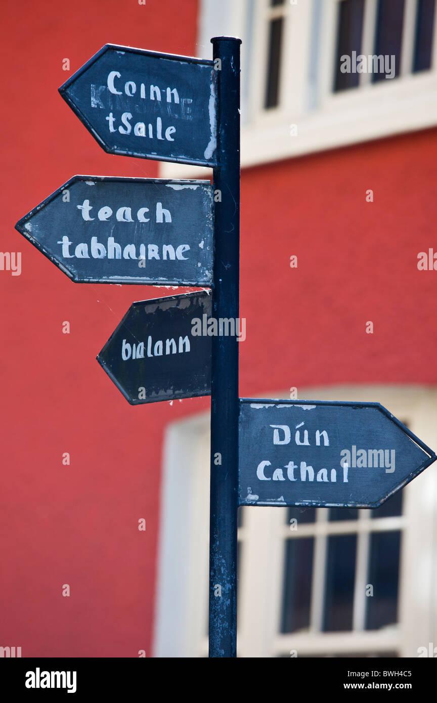 Signpost in old gaelic script in Timoleague, County Cork, Ireland - Stock Image