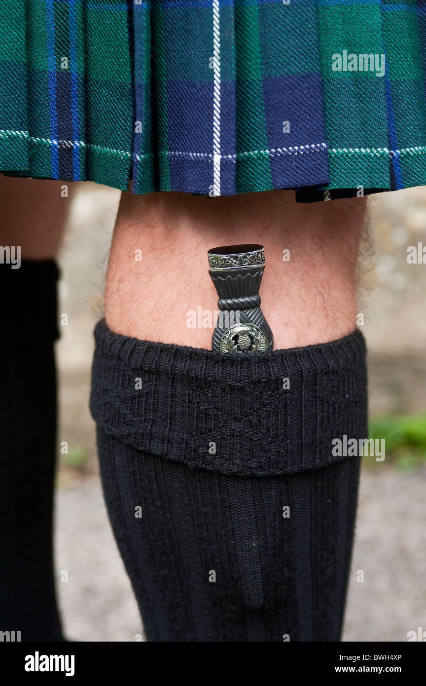 Vertical close up of a Scotsman in traditional dress with his sgian dubh (skean dhu or skene dhu) hilt visible from - Stock Image