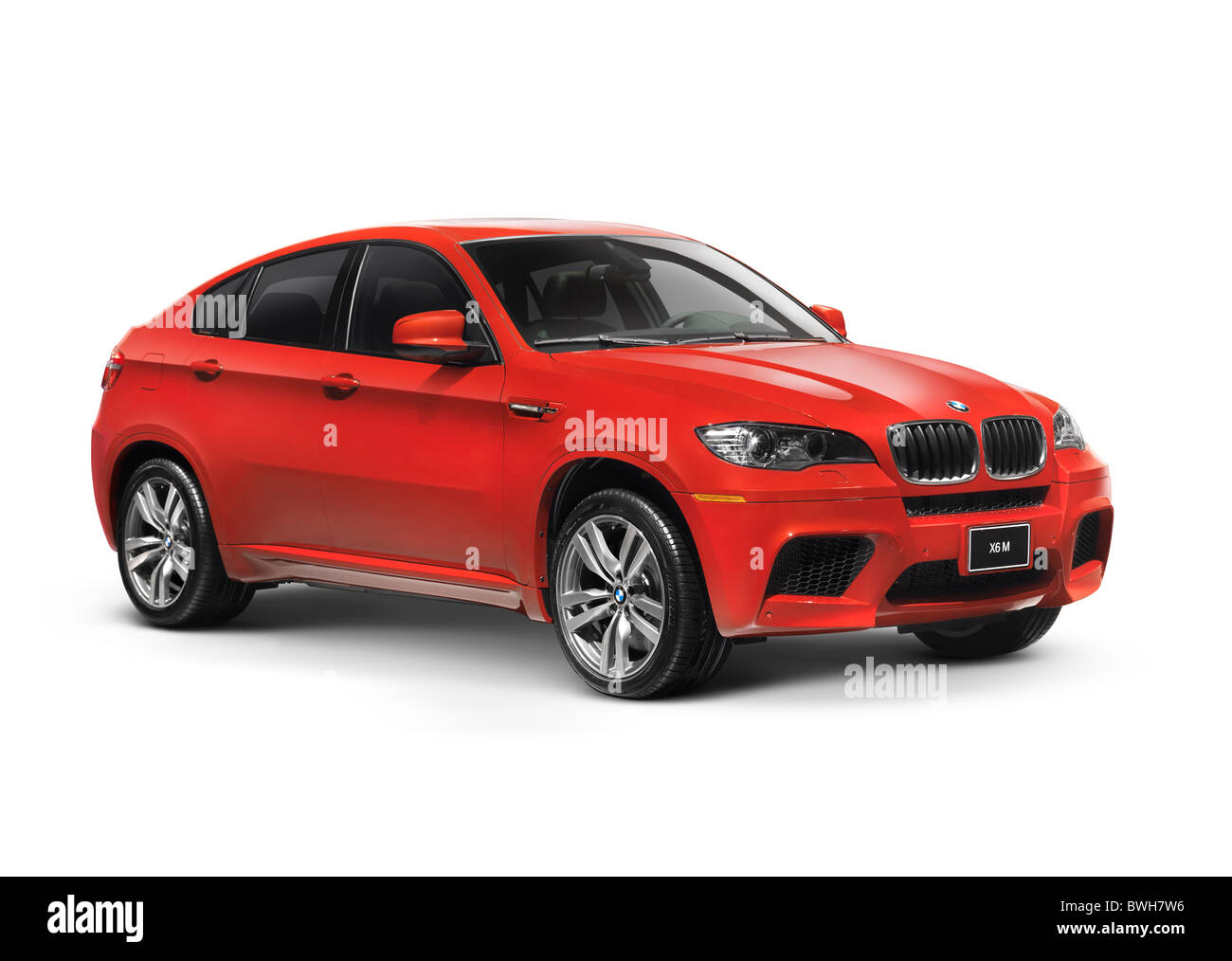 Red 2011 BMW X6 M crossover. Isolated car on white background with clipping path. - Stock Image
