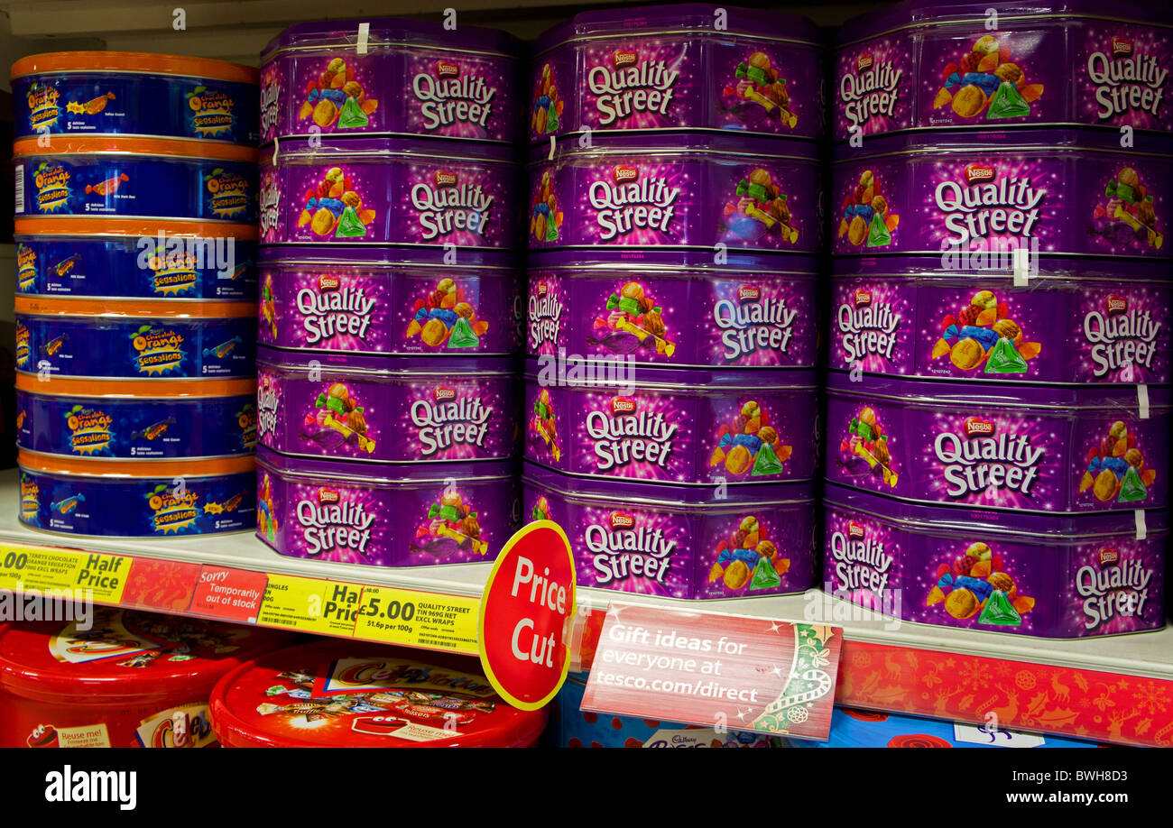 Tins of christmas sweets in a supermarket - Stock Image
