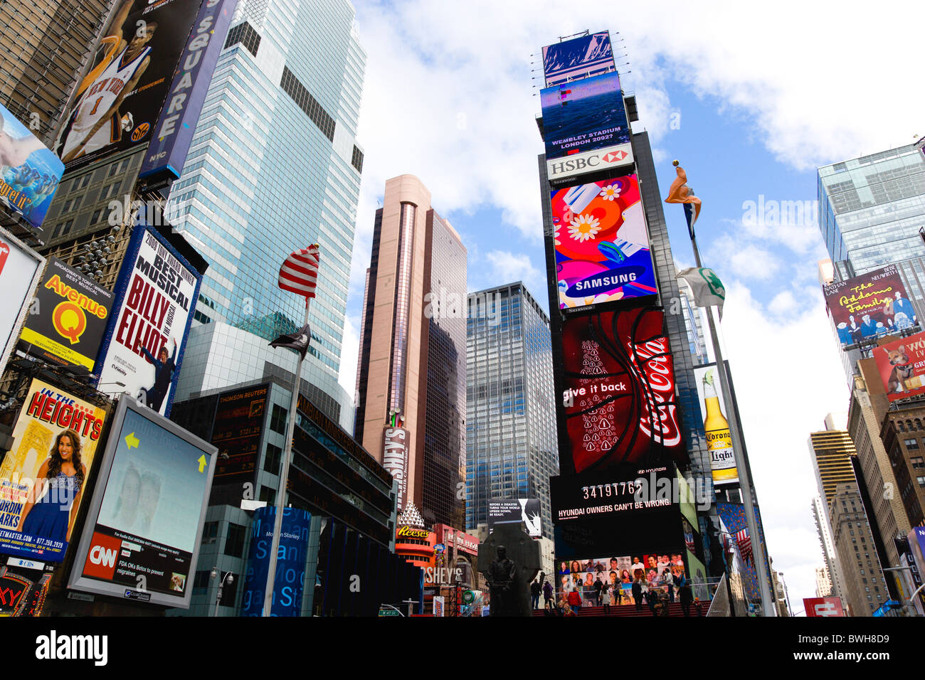 USA New York NYC Manhattan Times Square at the junction of 7th Avenue and Broadway below buildings with advertising - Stock Image