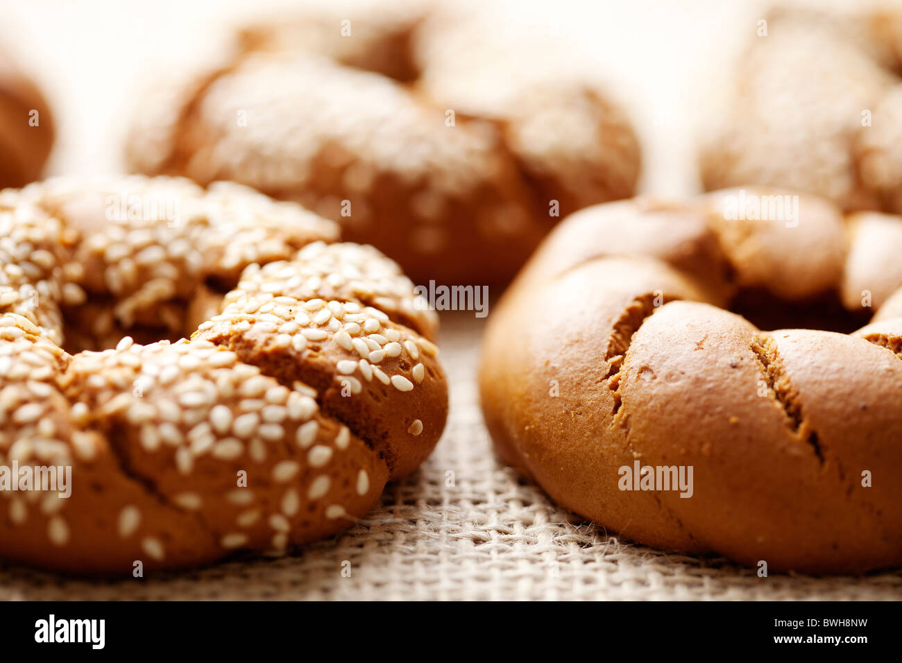 fresh rustic bread/bagels, shallow dof - Stock Image