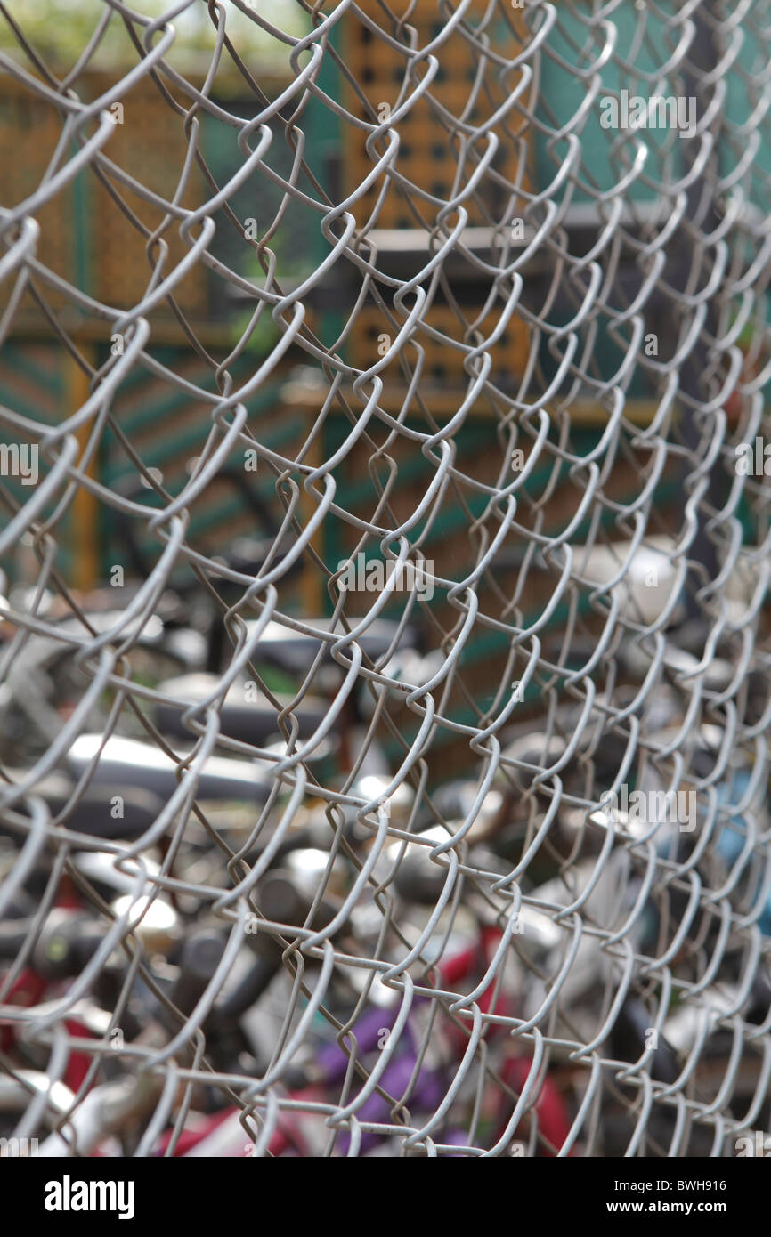 bicycles behind chicken wire mesh Stock Photo: 32957042 - Alamy