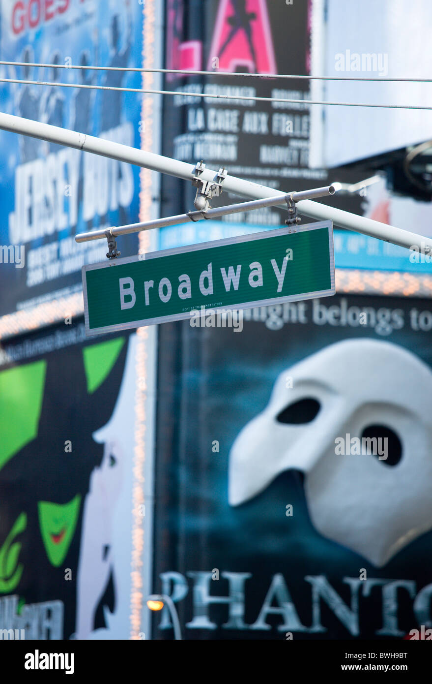 USA, New York, Manhattan, Overhead road sign for Broadway with theatre stage show posters or billboards on buildings - Stock Image