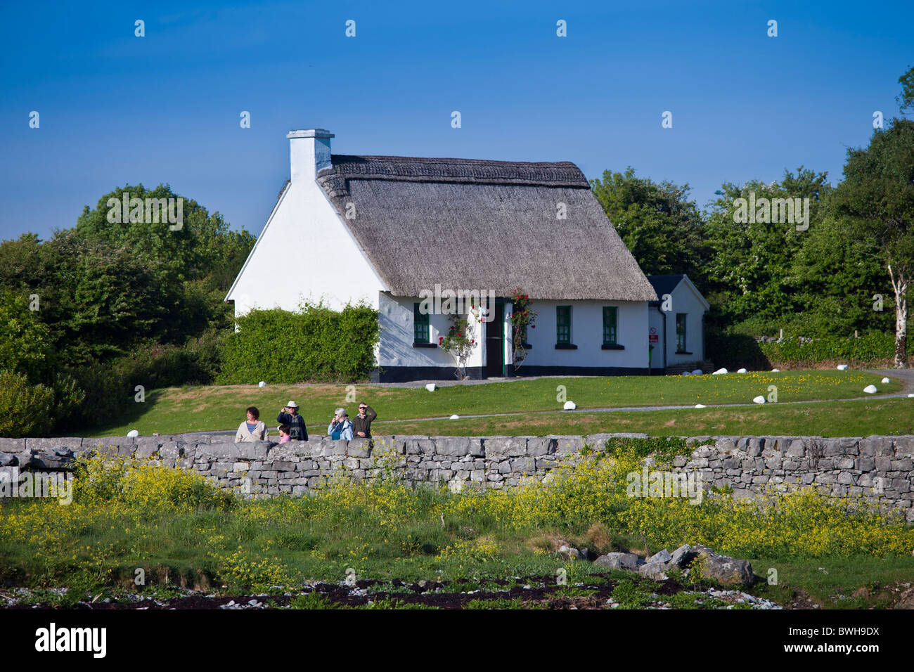 Thatched holiday cottage in Ballyvaughan, County Clare, Ireland - Stock Image