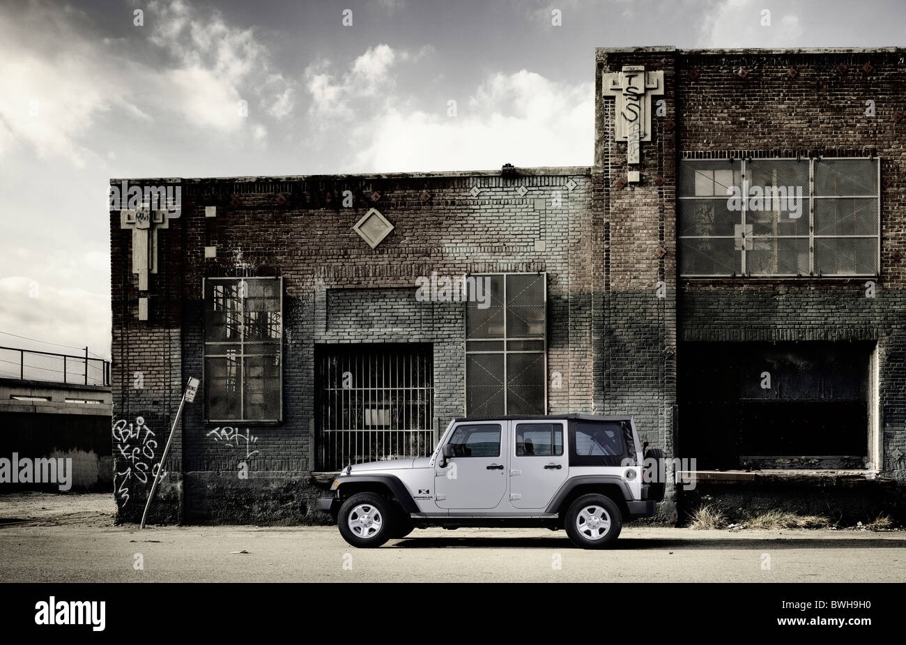 Transportation Jeep profile static beauty set in urban environment during daylight - Stock Image