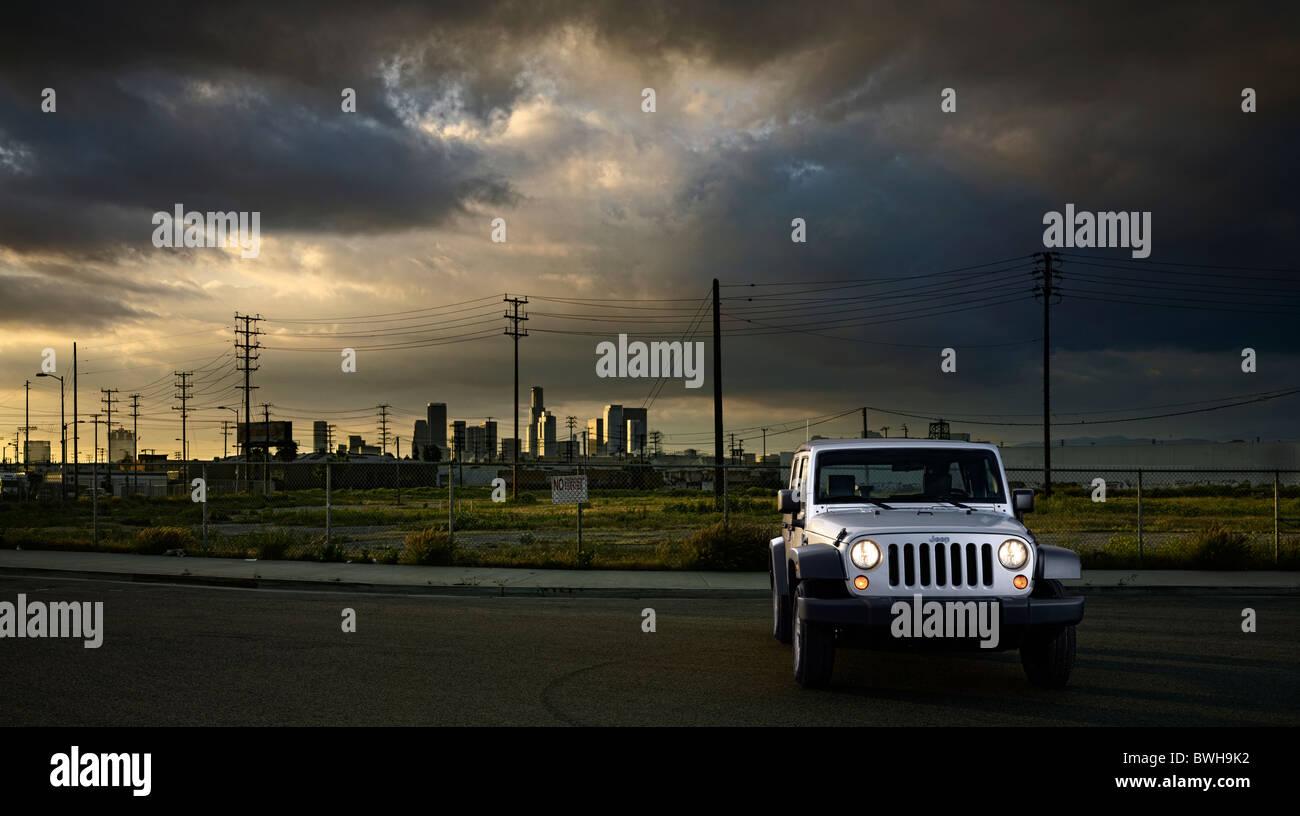 Jeep Wrangler set in urban landscape at sunset.  Front 7/8 static beauty shot - Stock Image