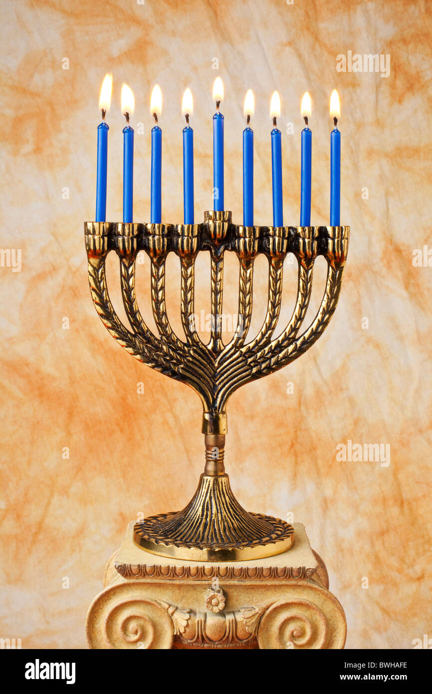 Menorah with blue candles on pedestal Stock Photo