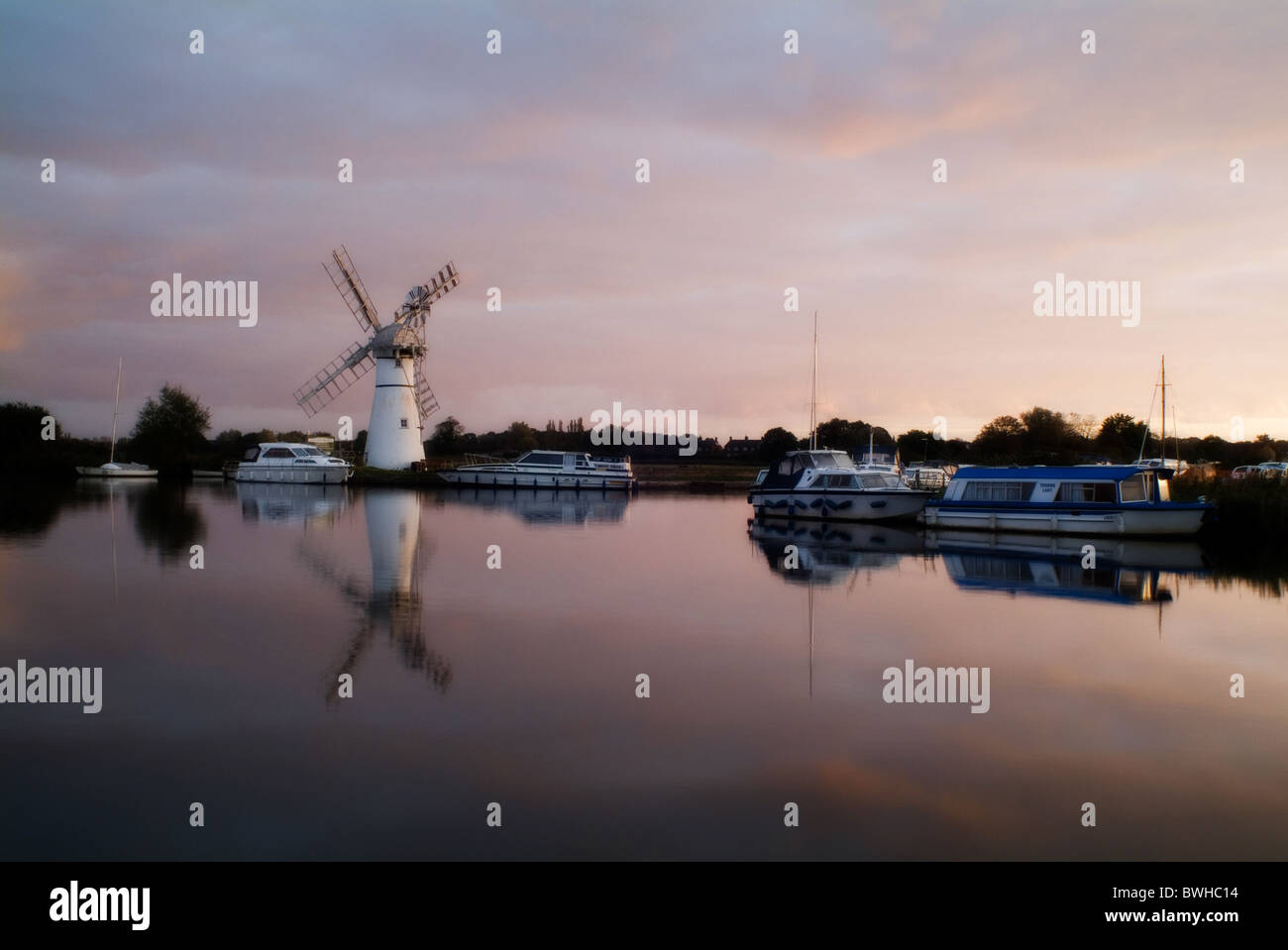 A photograph of Thurne windmill in the Norfolk Broads taken a dawn - Stock Image