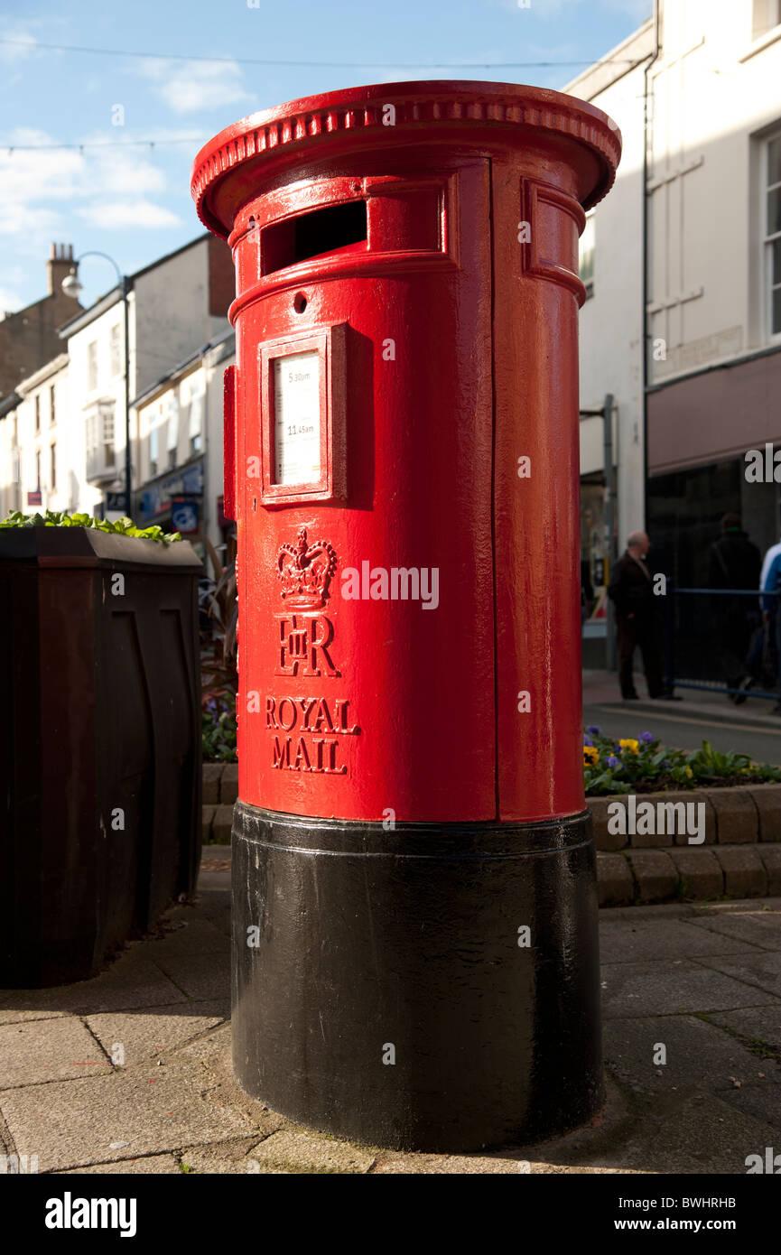 Red Royal Mail pillarbox postbox, UK - Stock Image