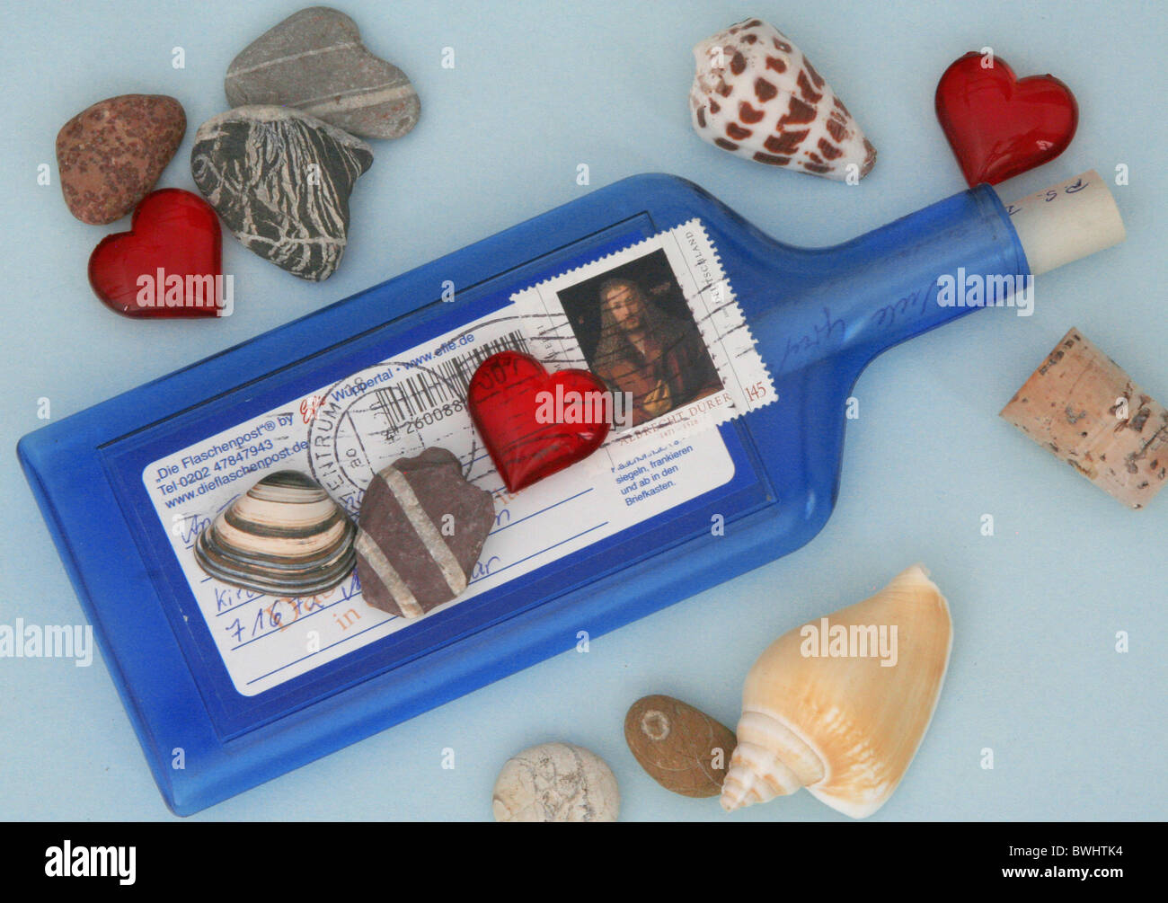 bottle post greetings letter stamp written writing write writing handwriting post mail notification messag - Stock Image