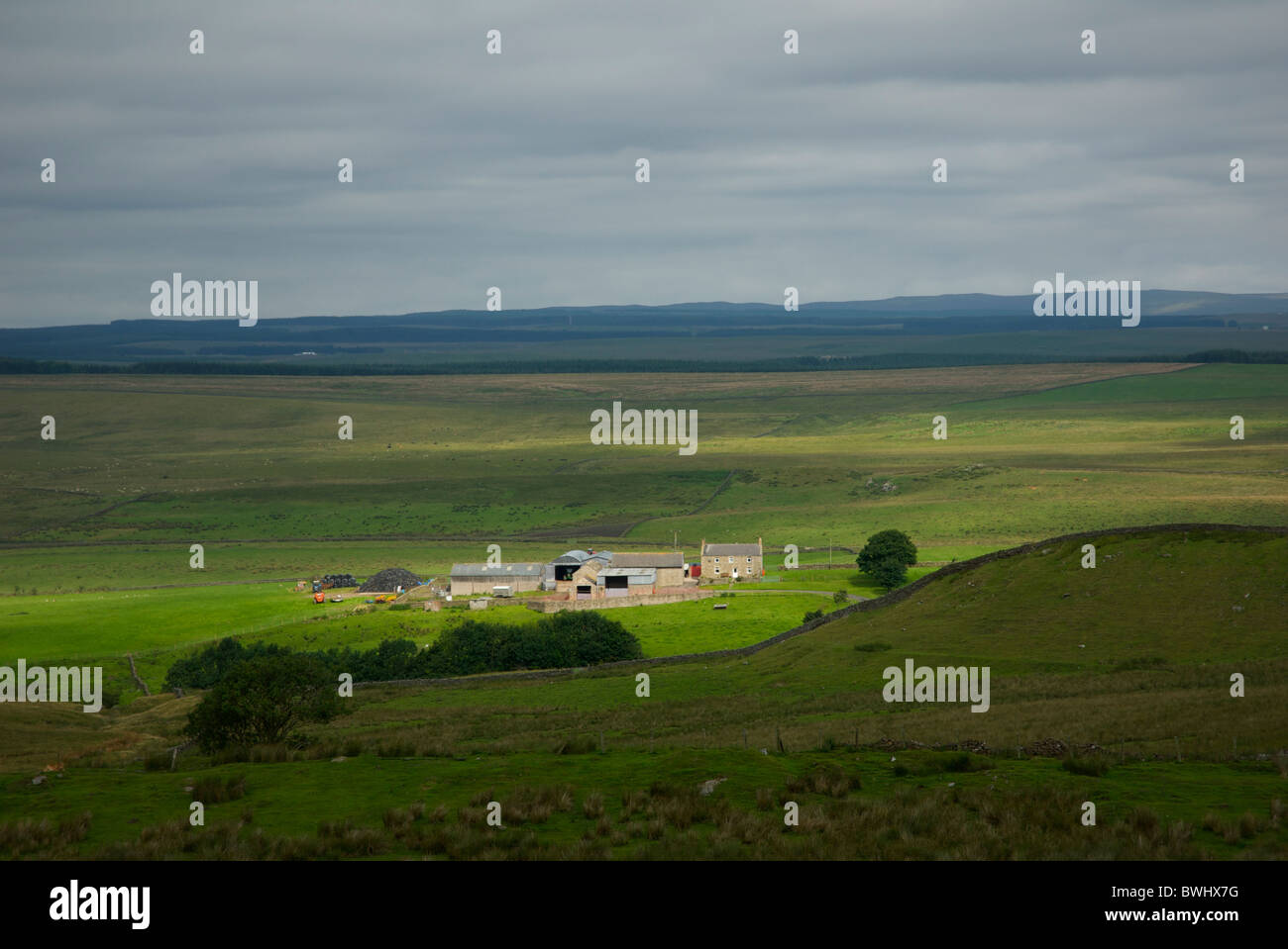 Farm near Greenhead, Cumbria, England, UK, from the viewpoint of Hadrian's Wall. - Stock Image