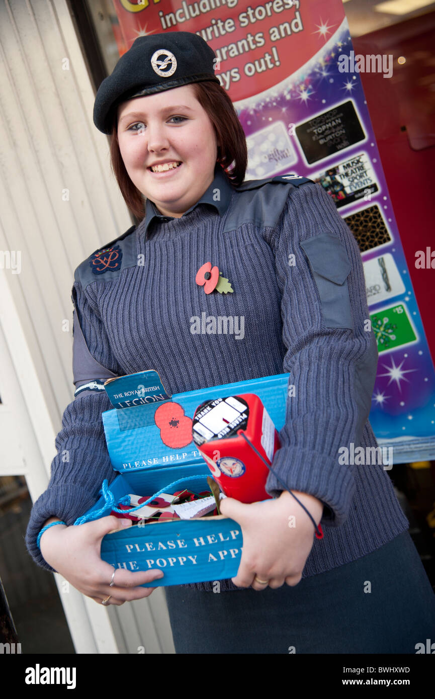 A young girl member of the Air Training Corps selling red Remembrance Day poppies UK - Stock Image