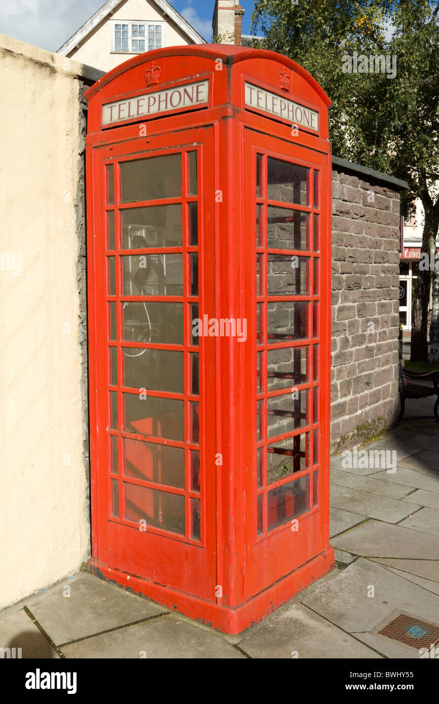 Traditional British red phone box kiosk in Brecon, Wales - Stock Image