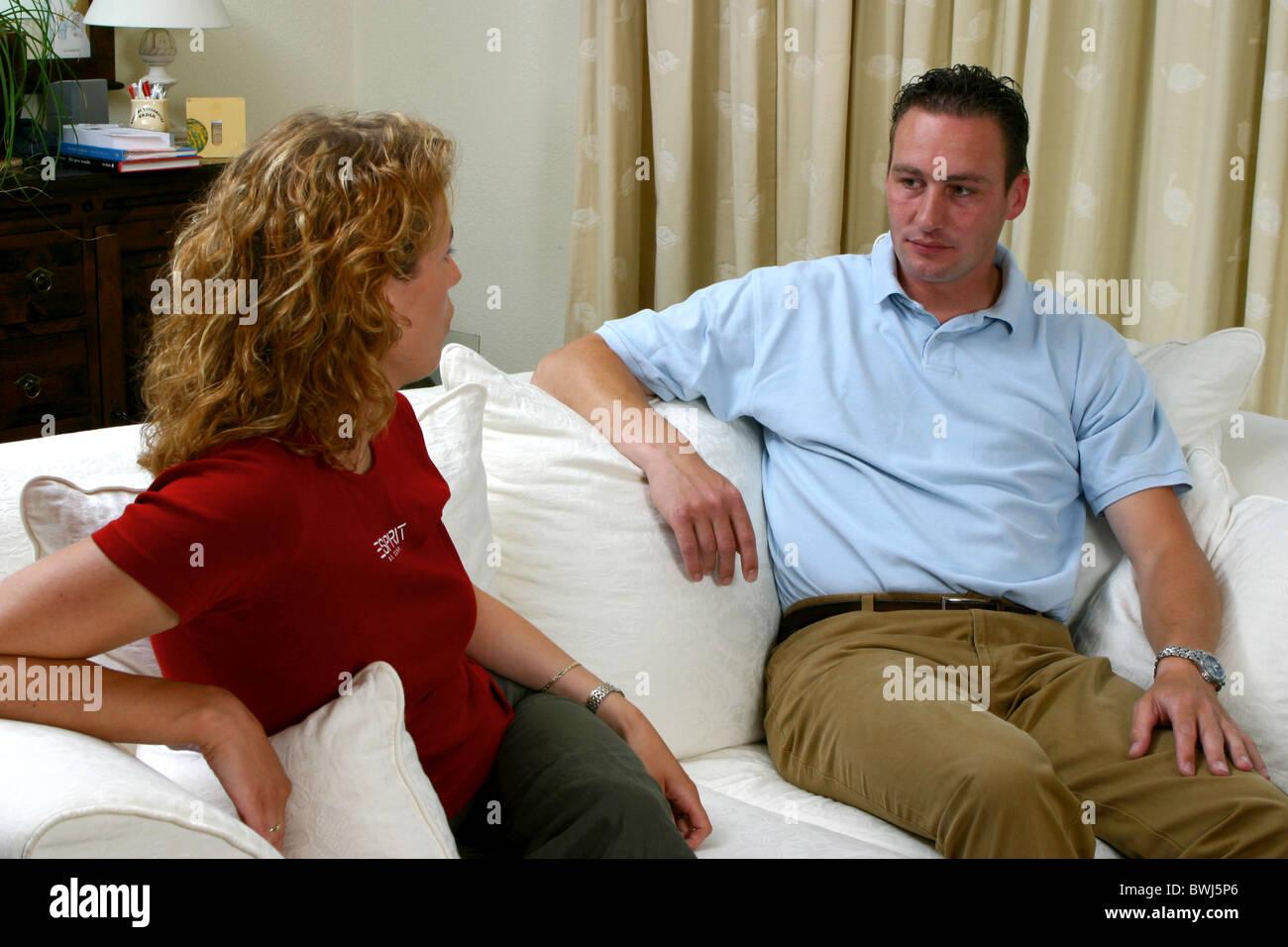 Couple sofa talking Stock Photo