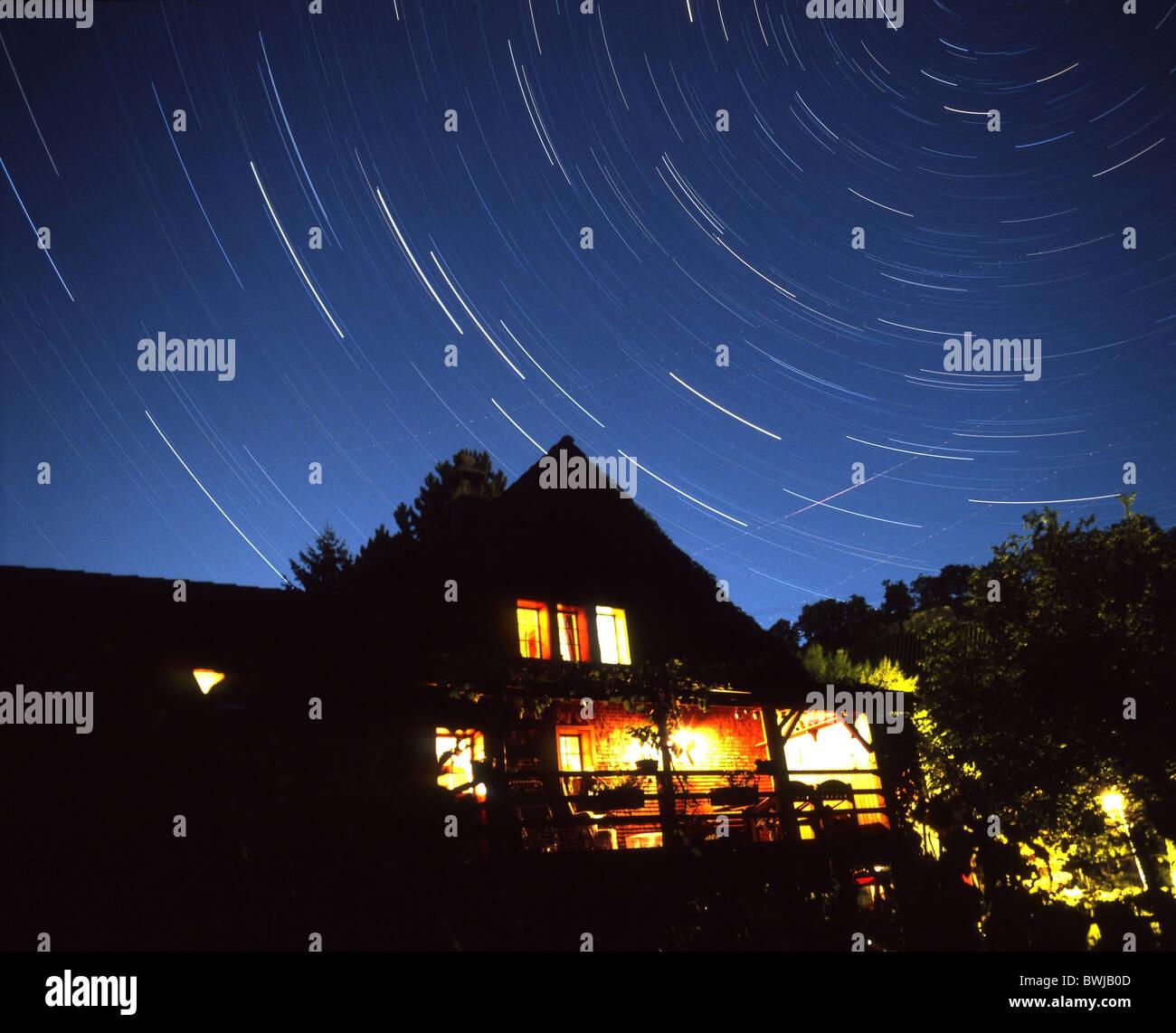 star sky star tracks time exposure house home illuminated stars night sky sky at night night - Stock Image
