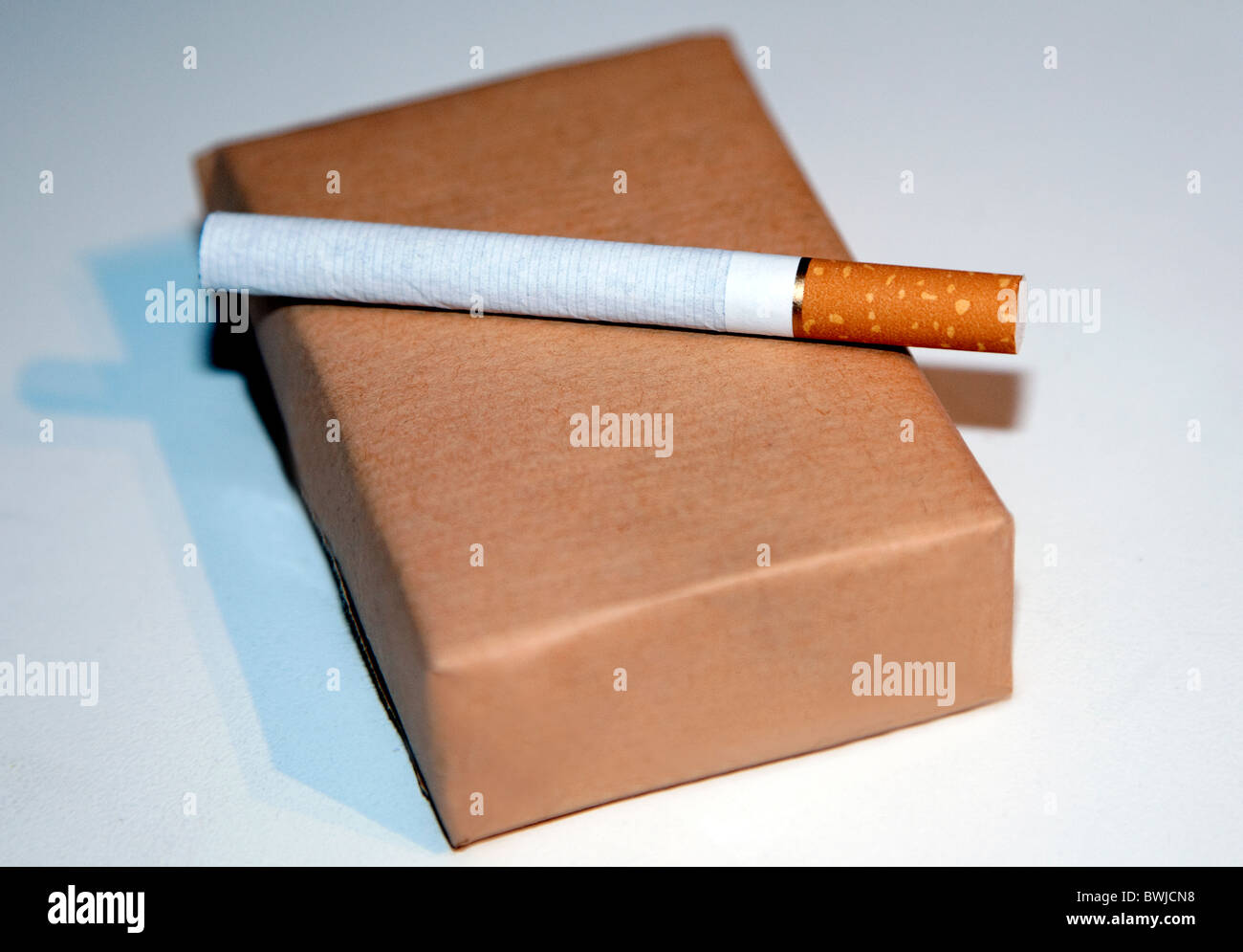 Cigarettes may be sold in the UK in plain brown or grey packets - Stock Image