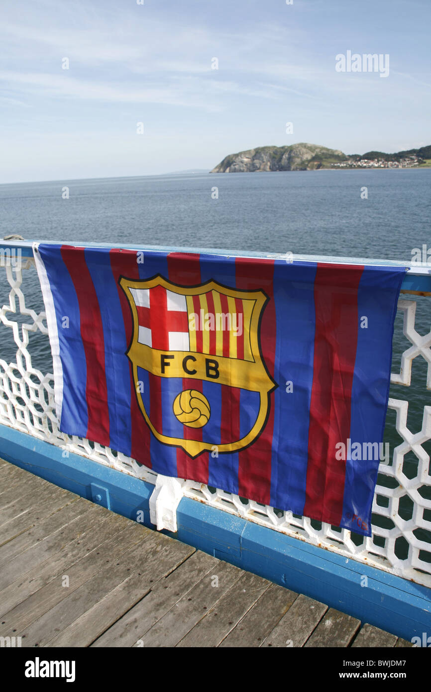 football club banners for sale on llandudno pier, north wales - Stock Image