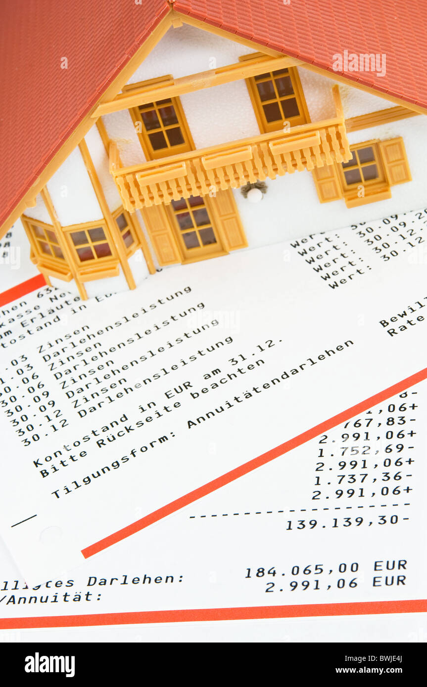 Model house on loans account statement - Stock Image