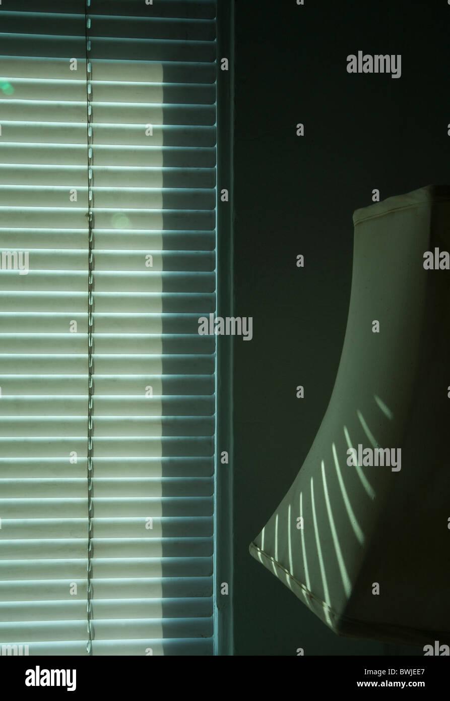 lampshade, window blinds, graphic, monochromatic, interior, sunlight, stripes, interior view of window - Stock Image