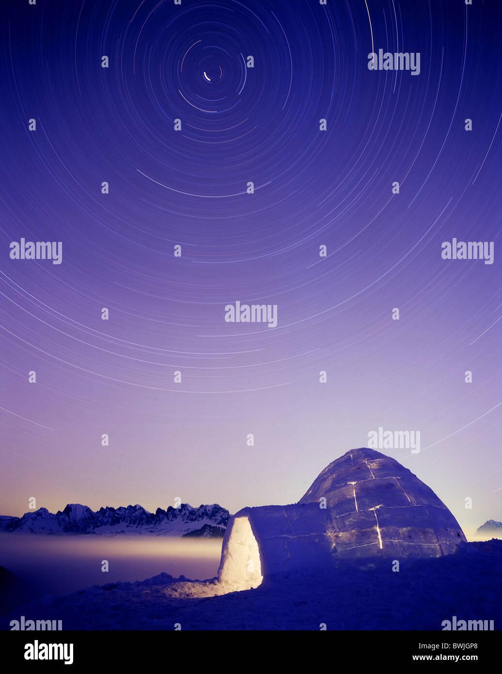 igloo illuminated Pizol night sky time exposure stars star sky circles rings mountains Alps winter snow du - Stock Image