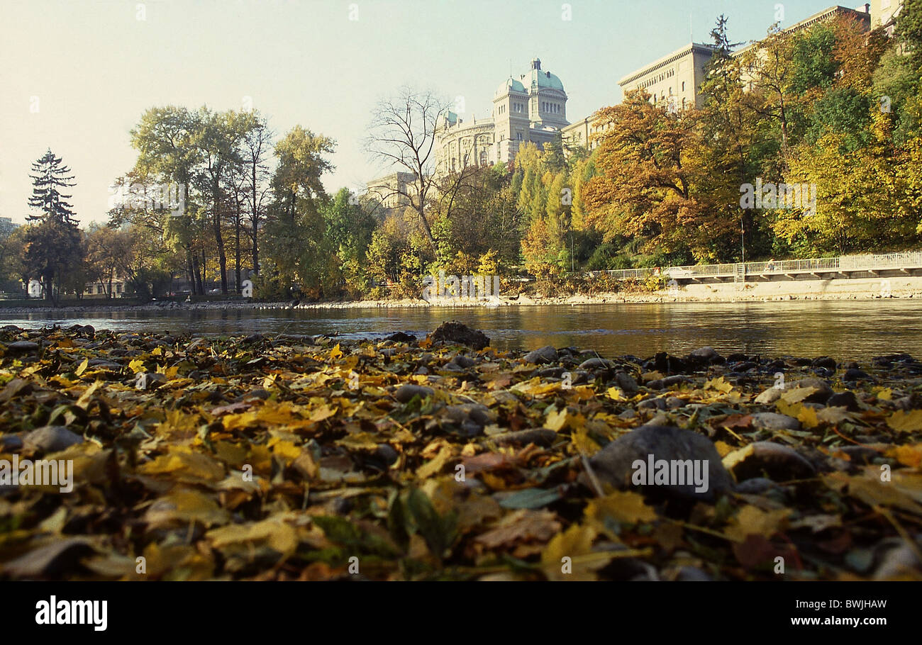 Federal Parliament Building town city Bern Berne building construction Aare shore foliage autumn Switzerlan - Stock Image