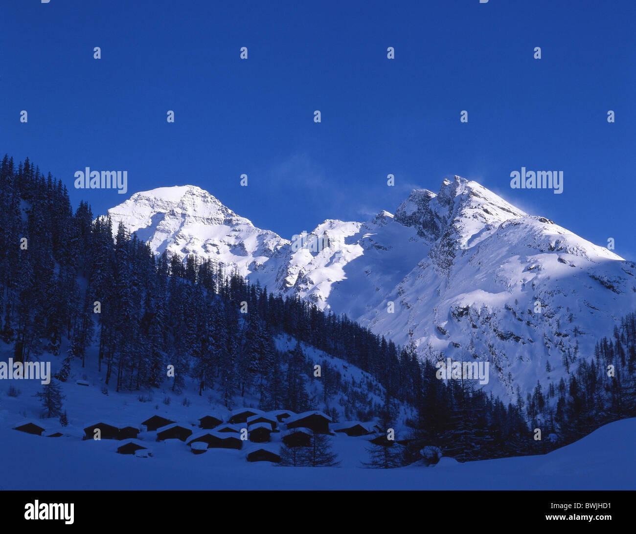 Lotschental Fafleralp hamlet settlement shade winter snow mountains Alps dusk twilight mood canton Valais - Stock Image