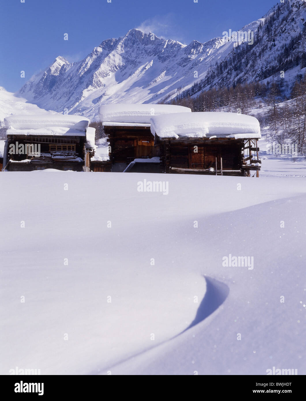 Lotschental hamlet snowbound snow-covered snowy alpine huts huts barns fresh snowfall snow mountains valley - Stock Image