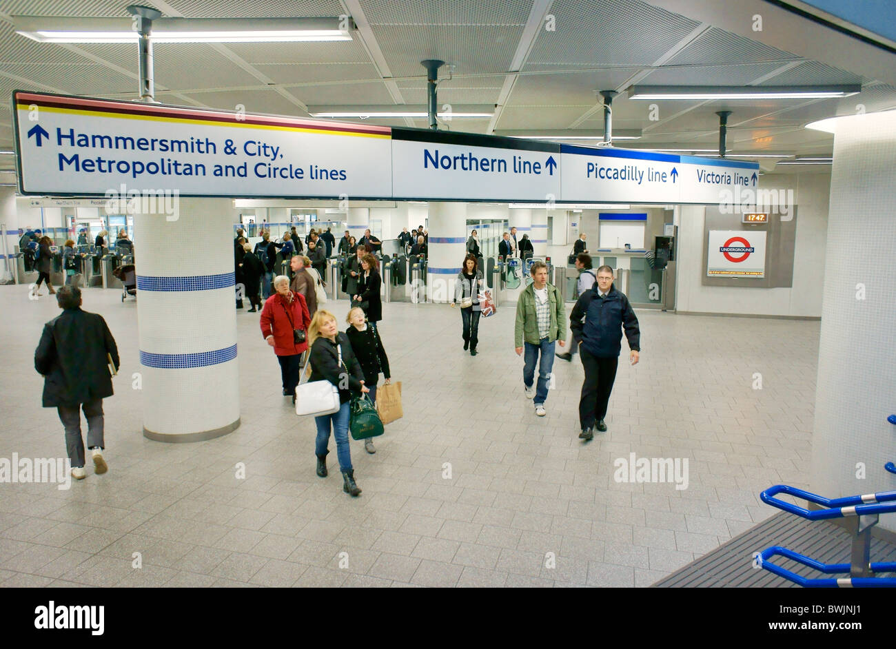 Kings Cross St. Pancras underground tube station on Euston Road, London. New entrance exit foyer, travellers and - Stock Image