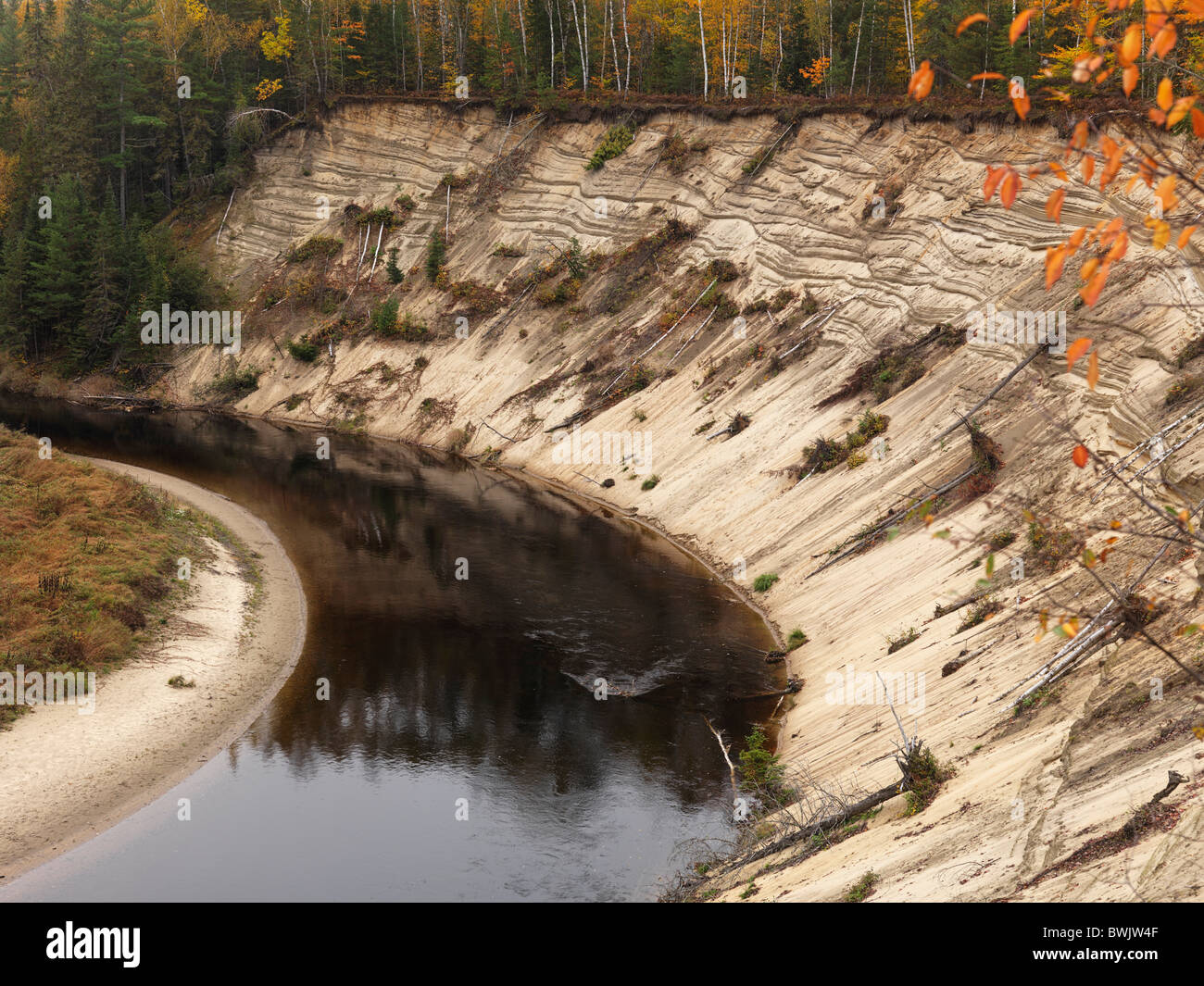 Erosion of a bank on a bend of Big East River. Arrowhead provincial park, Ontario, Canada. - Stock Image