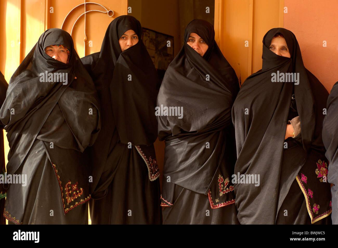 woman portrait veils Islam veil Muslims Islam Argan Oil Coorporative Al Baraka Douar Ini In'Tizghrt Ameln Valley - Stock Image