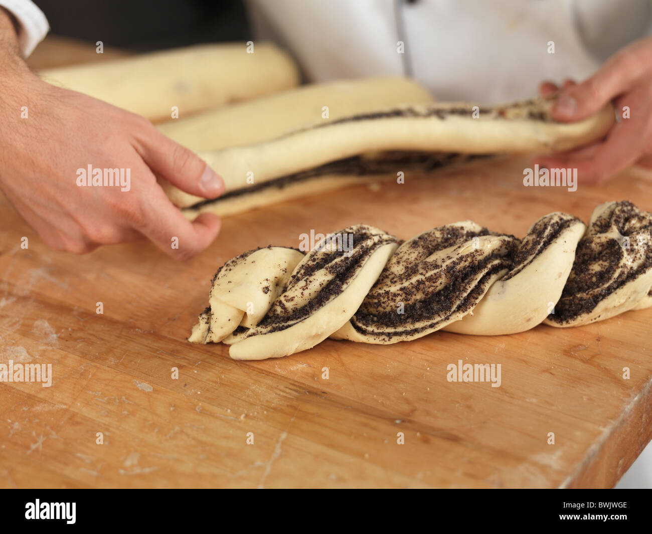 Baker making pastries. Closeup of hands. Stock Photo