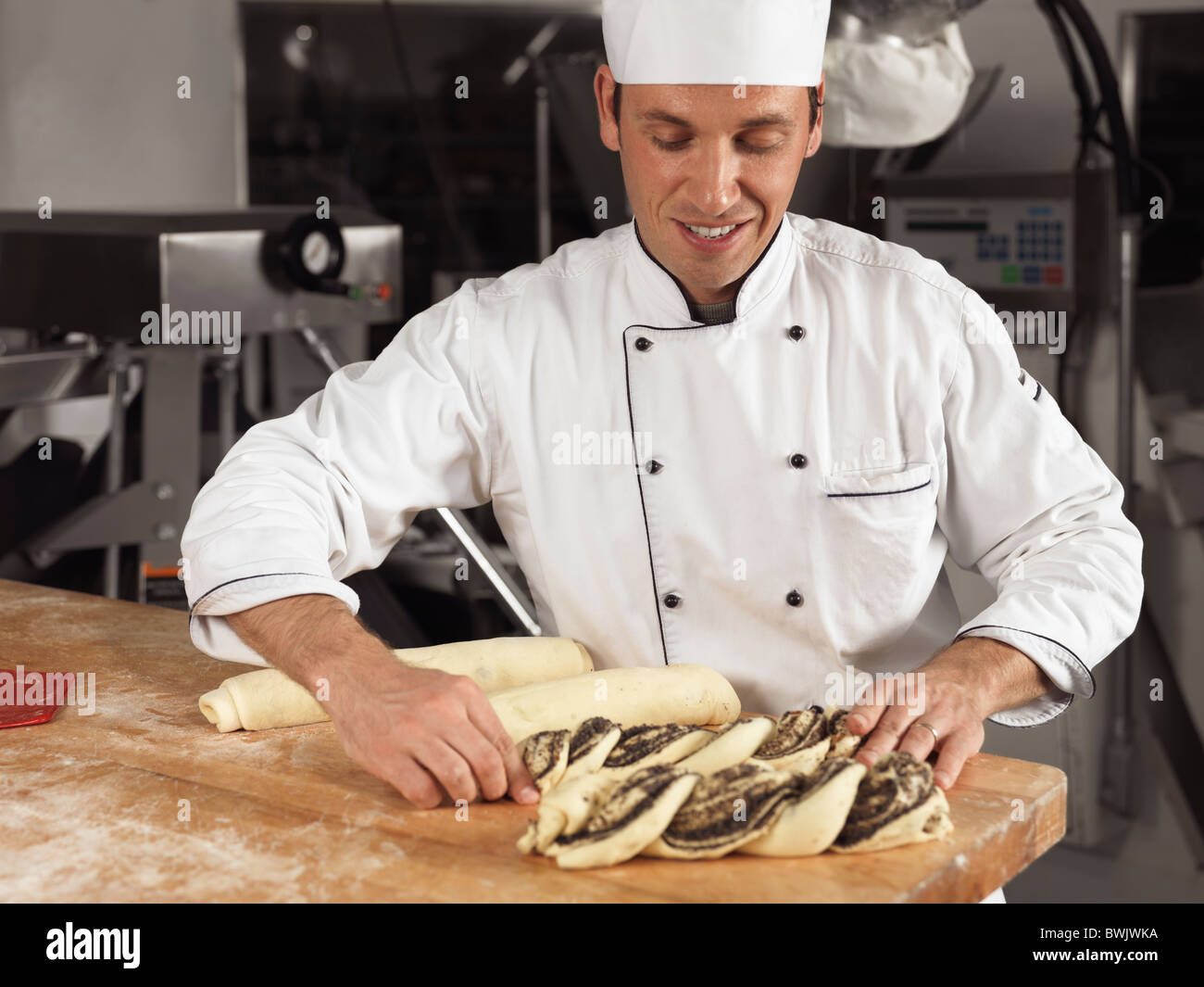 Portrait of a baker making pastries in a bakery Stock Photo