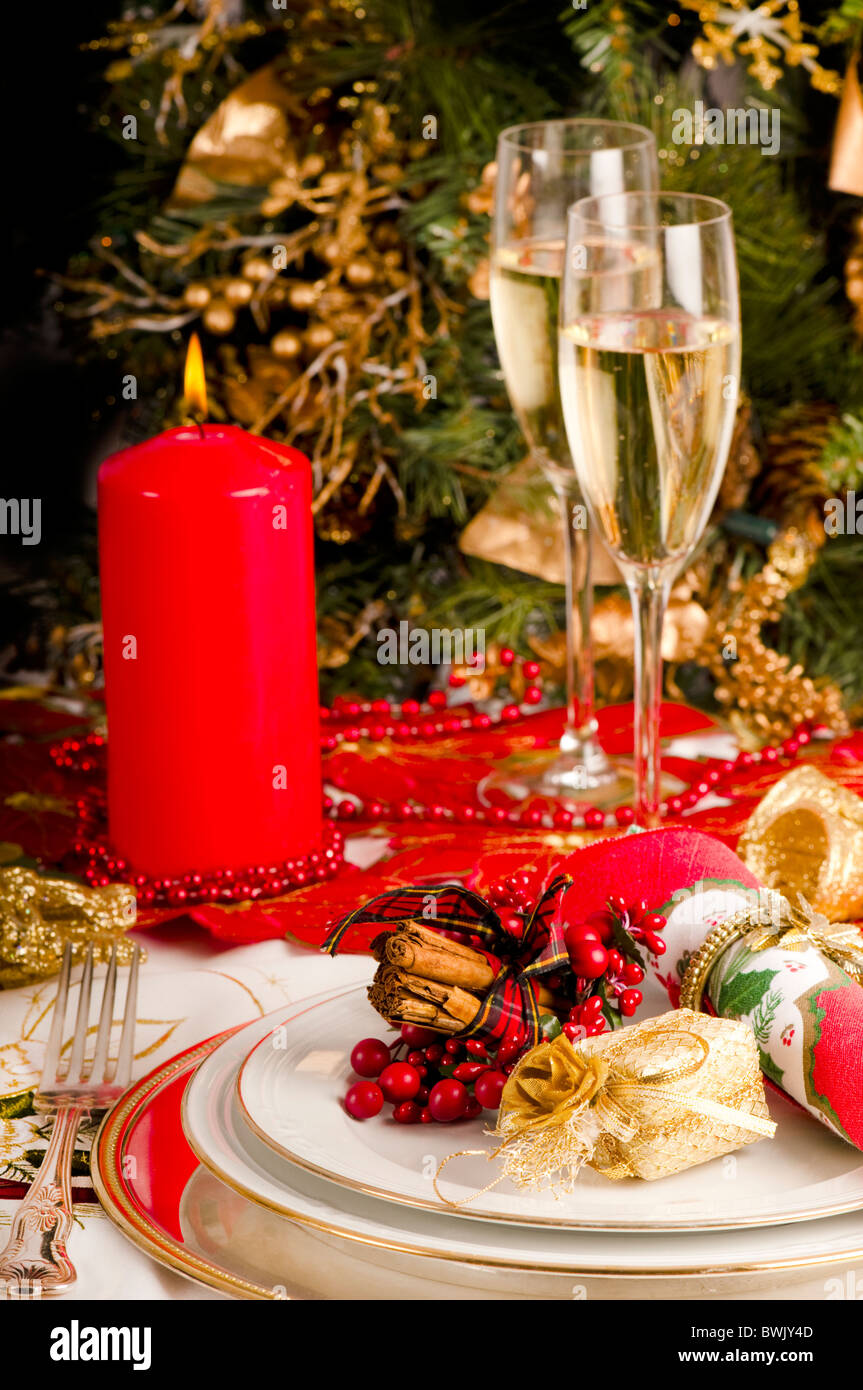Christmas table setting with wine glass and two glasses of ch&agne Red and gold decorations and presents & Christmas table setting with wine glass and two glasses of champagne ...