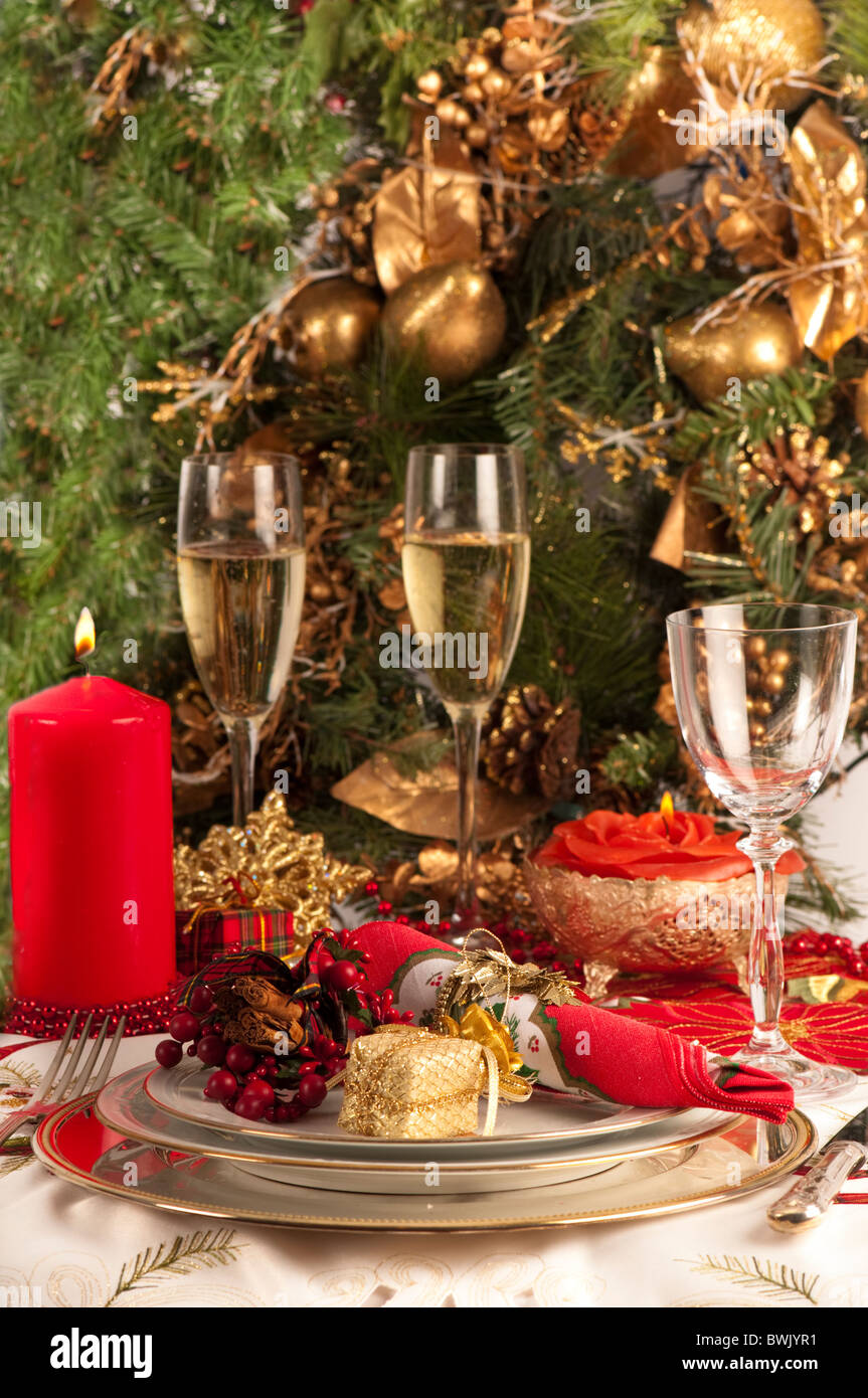 Christmas Table Setting With Wine Glass And Two Glasses Of Champagne