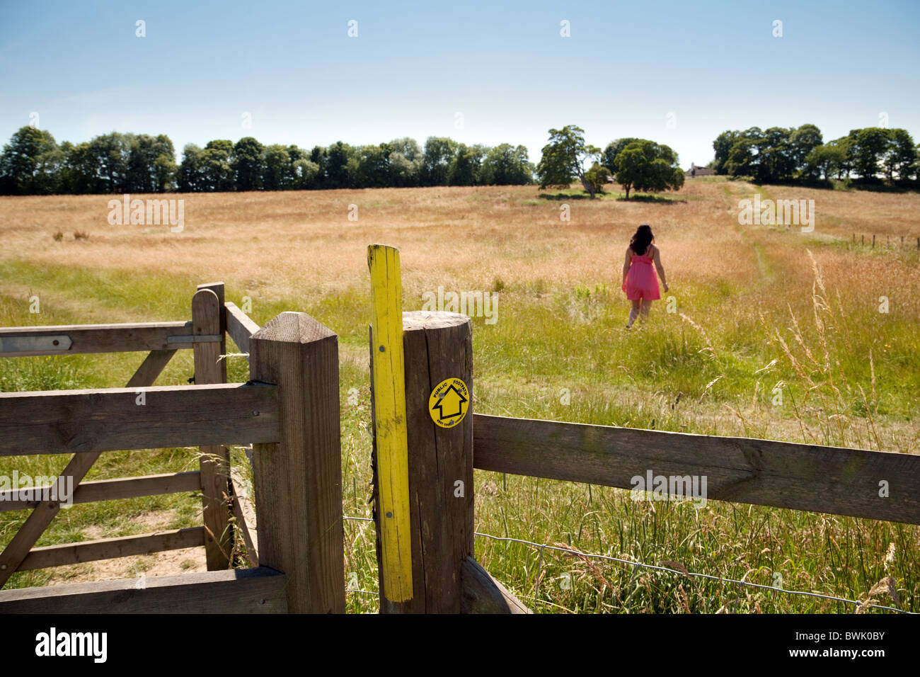 Teenage girl walking in the country on a summers day, Lyminge village near Folkestone, Kent UK - Stock Image