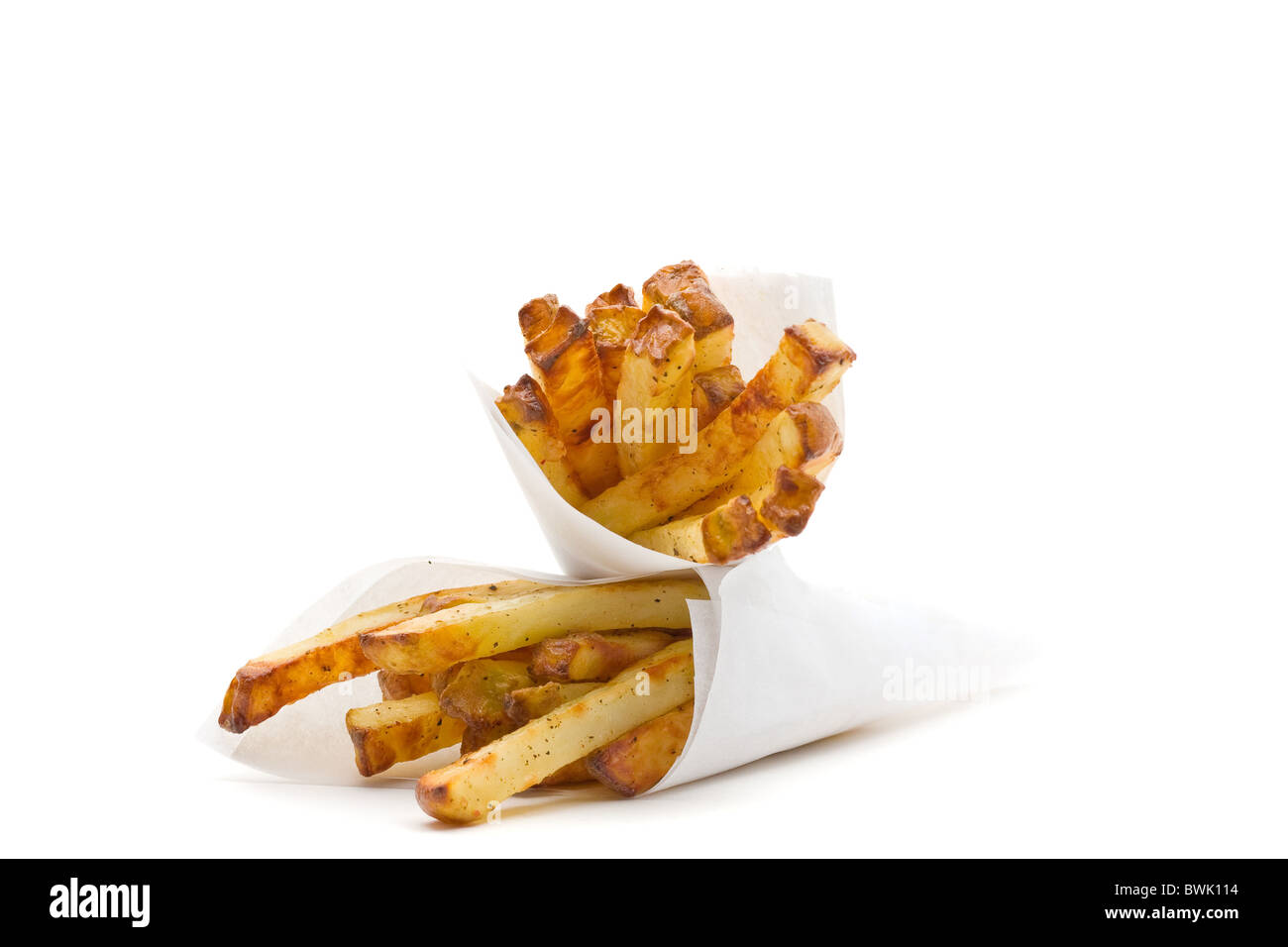 Two packs of home made french fries over white background - Stock Image