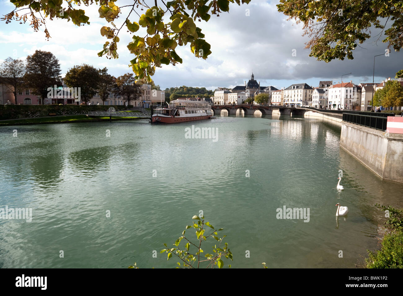 Swans on the river Marne in Meaux, Ile de France Northern France - Stock Image