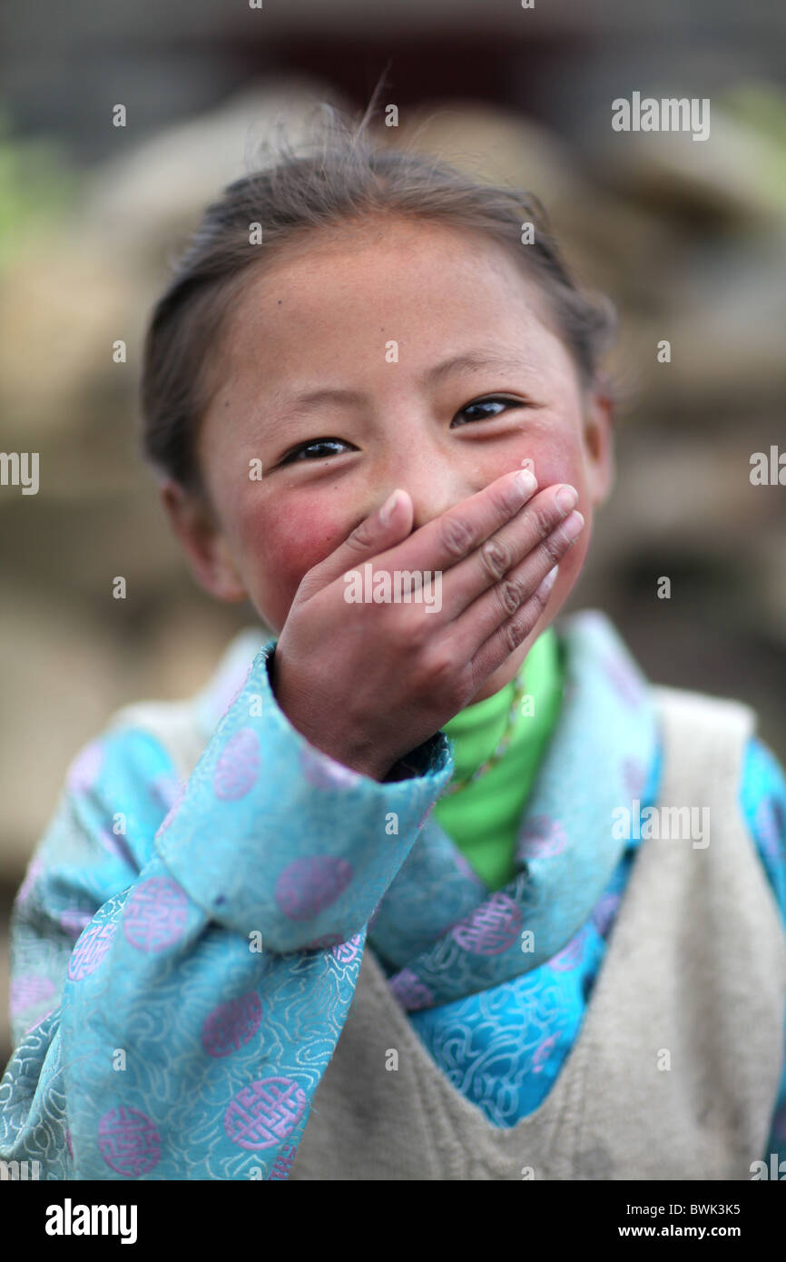 A laughing tibetan girl in Litang, Sichuan province, southwest China - Stock Image