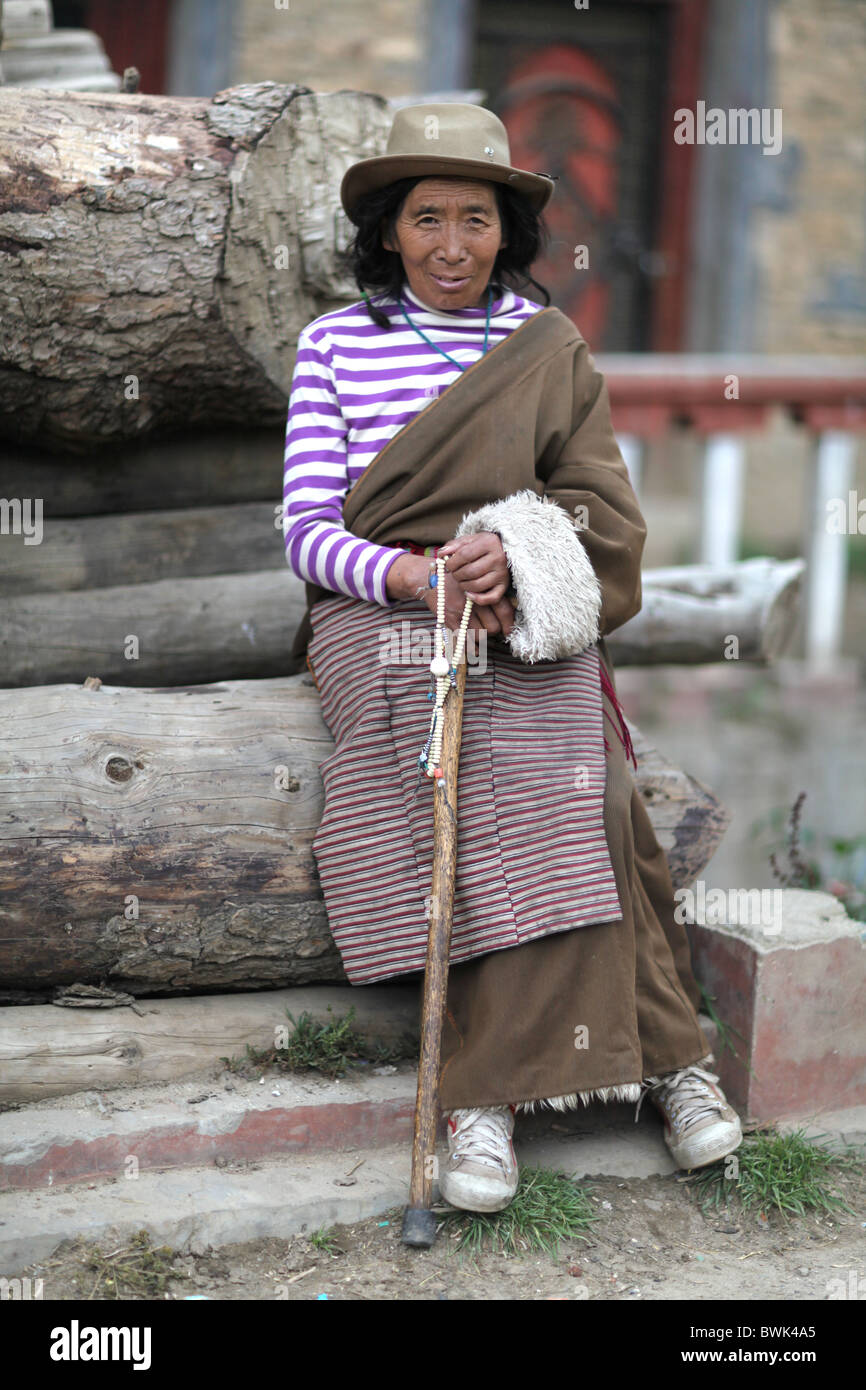 A smiling local woman in Litang, Sichuan province, southwest China - Stock Image