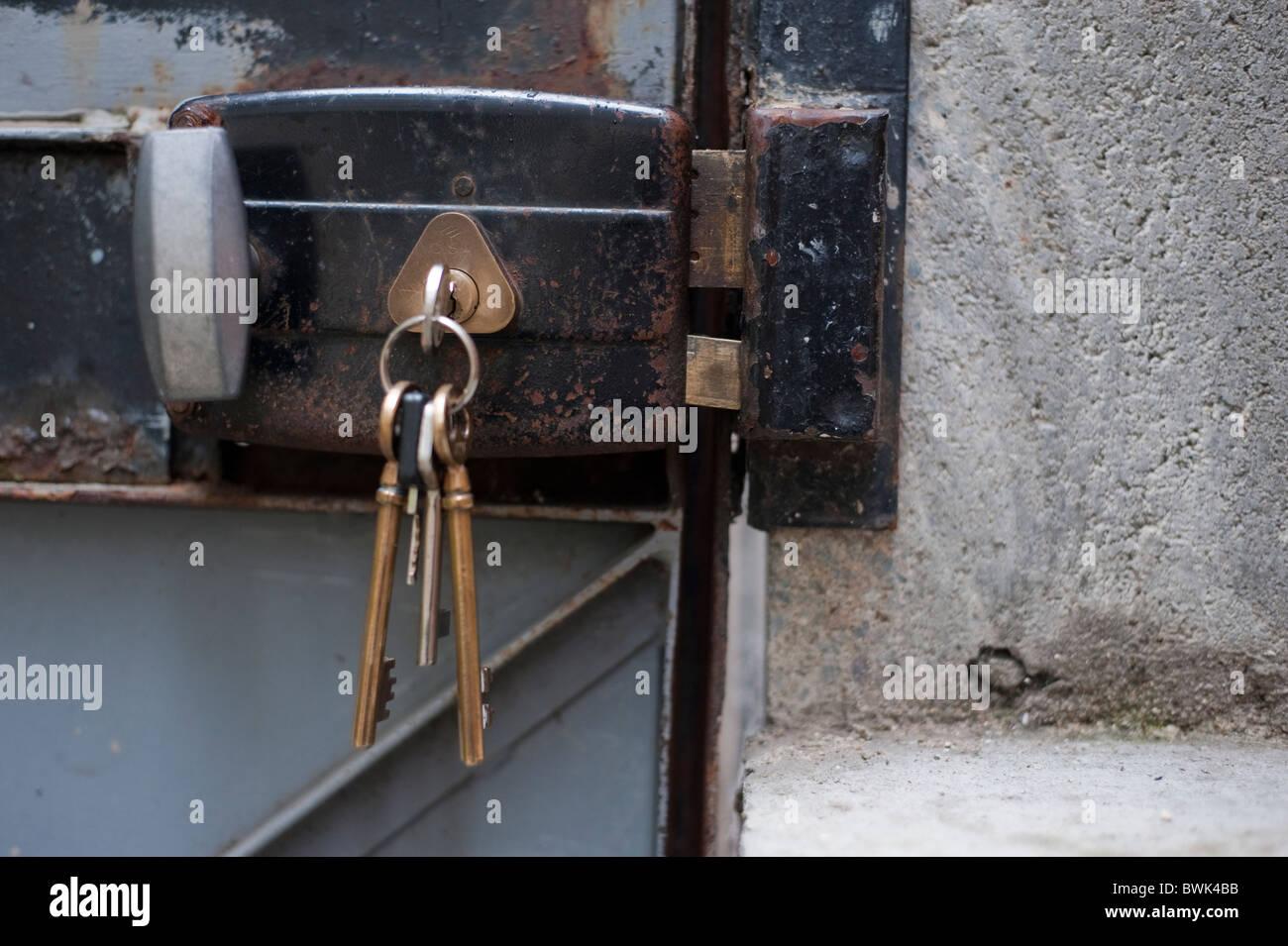 Keys In Old Metal Door Lock, Outside Residence Stock Photo ...
