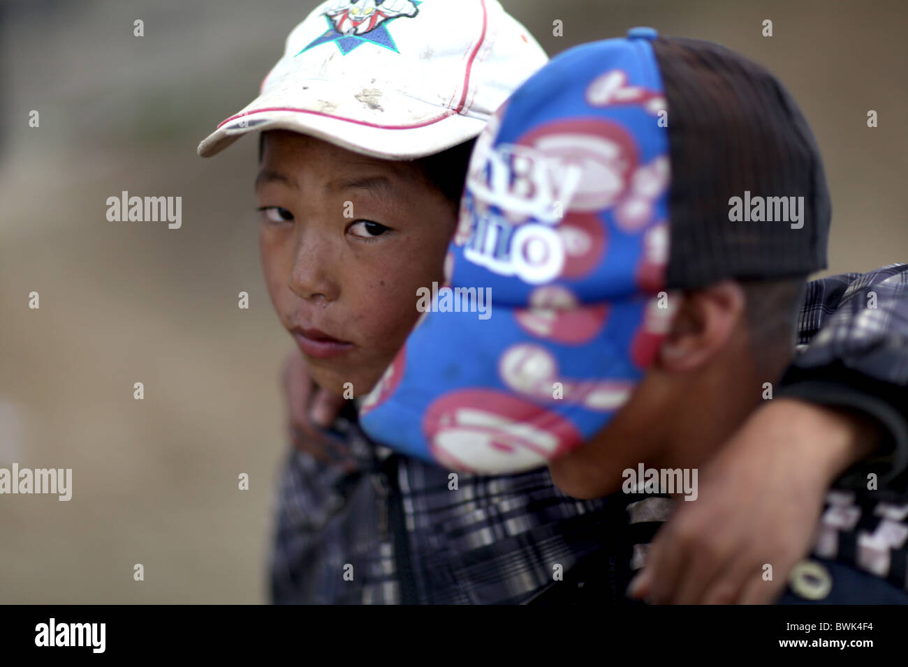 Two tibetan boys in Litang, Sichuan province, southwest China - Stock Image