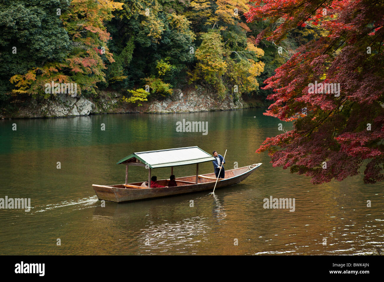 Boat tours down the Hozu River lead through a picturesque canyon at a leisurely pace with a local oarsman - Stock Image