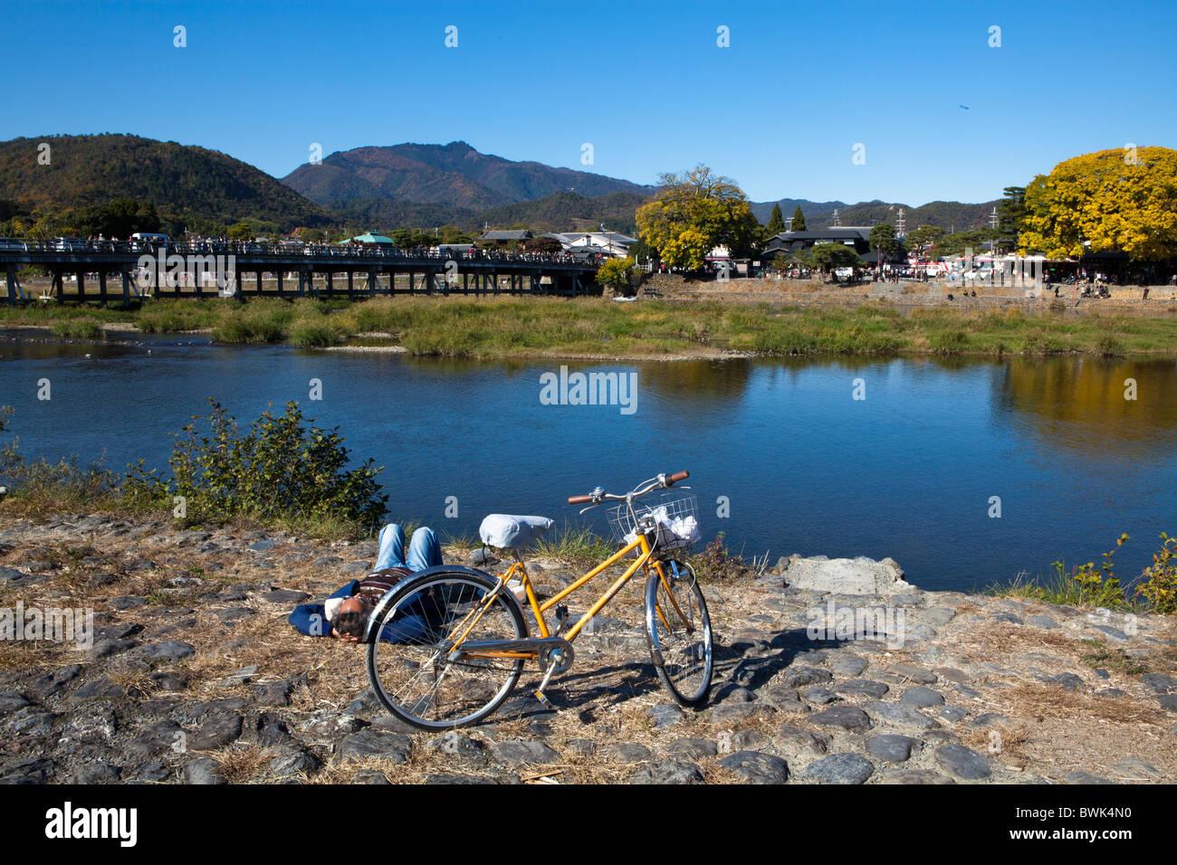 Togetsukyo Bridge over the Hozu River is a favorite riverside break in Arashiyama - Stock Image