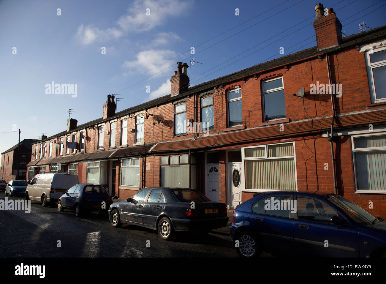 row of 2up 2down modernised victorian red brick terraced houses in manchester uk - Stock Image