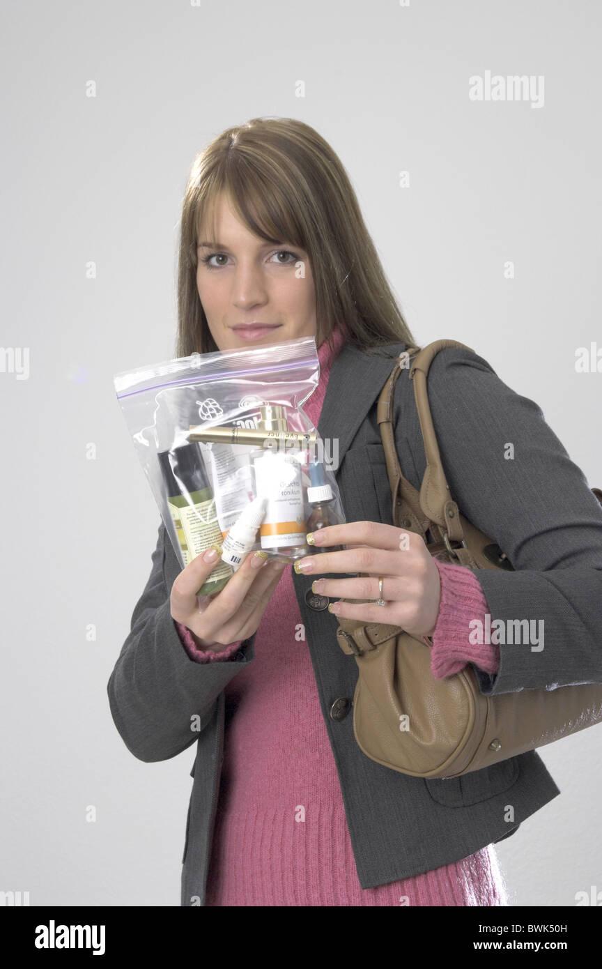 woman security regulations passenger passengers journeys by air liquids aviation vacation holidays tourism h - Stock Image