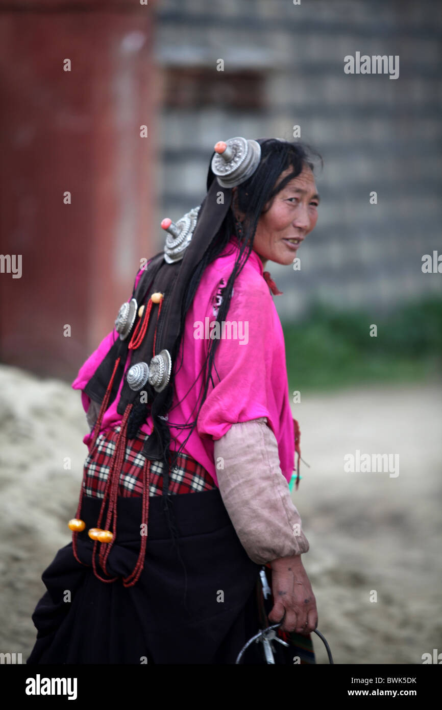 A tibetan woman in traditional clothing in Litang, Sichuan province, southwest China. - Stock Image