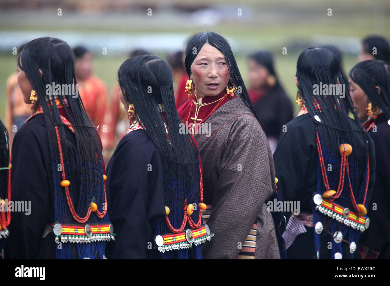 Traditionally dressed women at a local festival in the countryside near Litang, Sichuan province, southwest China - Stock Image