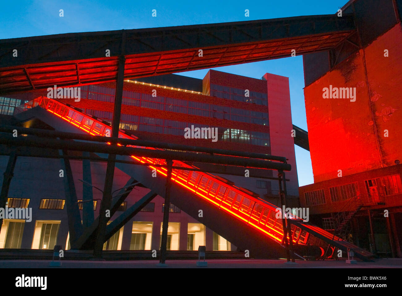 food pit Zollverein building construction neon red architecture industry modern Umnutzung at night night - Stock Image