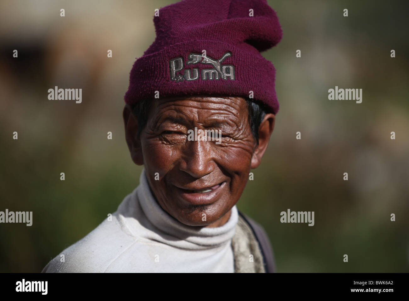 A smiling local man in Litang, Sichuan province, southwest China - Stock Image